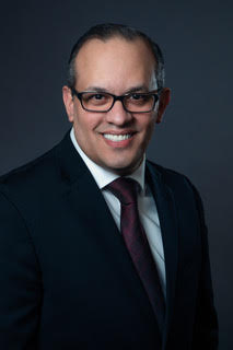 Minister Ben Pacheco